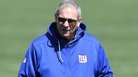 Giants general manager Dave Gettleman watche the final