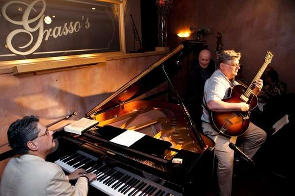 The Mark Marino trio performs jazz for patrons
