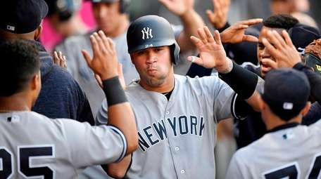 The Yankees' Gary Sanchez is congratulated in the