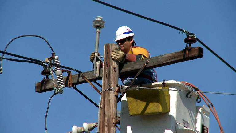 LIPA and National Grid workers fix powerlines on