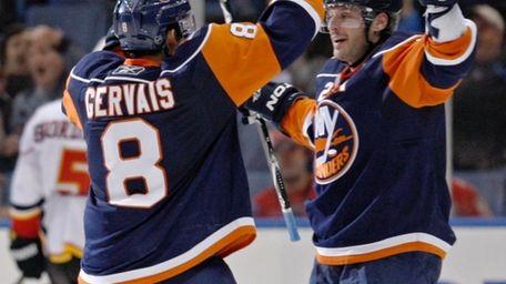 Islanders defenseman Mark Streit, right, celebrates with Bruno