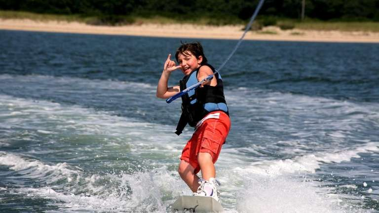 A camper wake-boards at Global Boarding