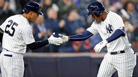 On-deck batter Gleyber Torres, left, congratulates teammate Miguel