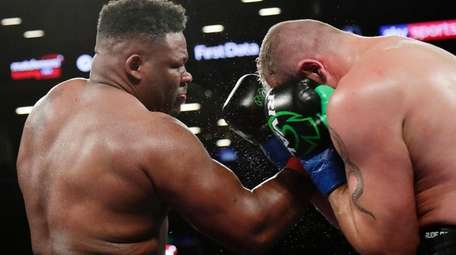 Jarrell Miller, left, punches Johann Duhaupas, of France,