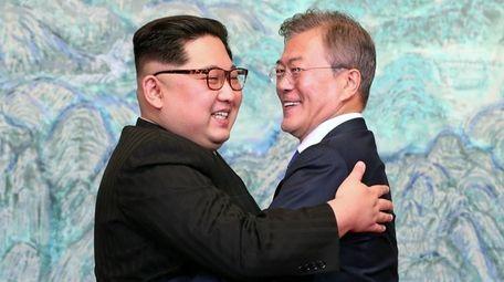 North Korea's leader Kim Jong Un, left, and