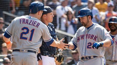 Mets' Adrian Gonzalez, right, celebrates his three-run homer