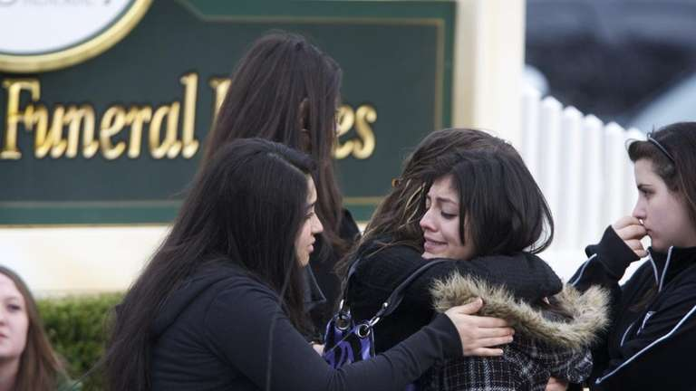 Mourners gather outside the funeral for 17-year-old Alexis