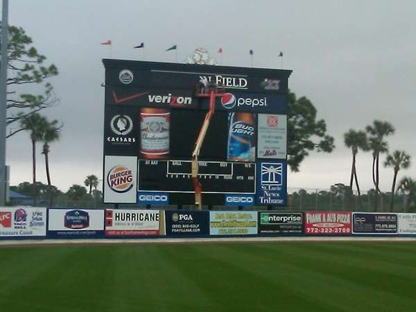 Workers tear down the Tradition Field sign last