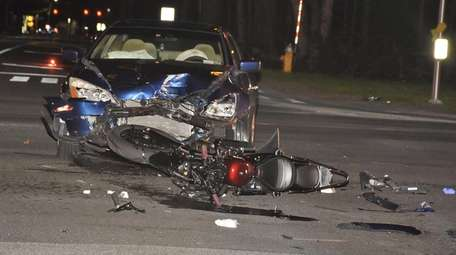 A motorcycle and a car collided at the