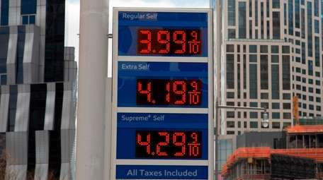 Gas prices are displayed at a Mobil station