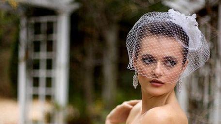 A model wears a Boutique de Voile birdcage