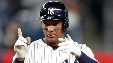 Yankees rookie third baseman Miguel Andujar gestures toward
