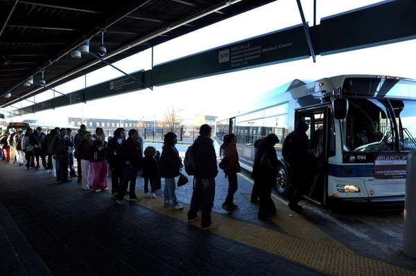 Commuters board the Long Island Bus N70 in