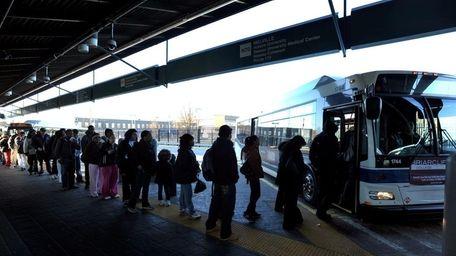 Commuters board the Long Island Bus N70 in