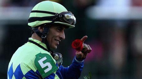 Jockey John Velazquez celebrates atop Always Dreaming after