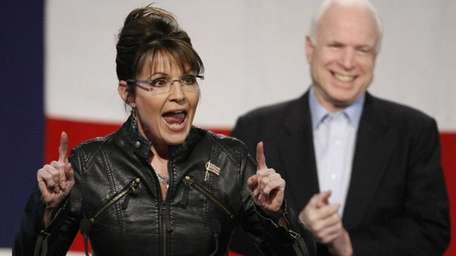 Sen. John McCain background right, and Sarah Palin,
