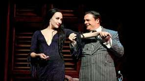 Bebe Neuwirth and Nathan Lane in a scene