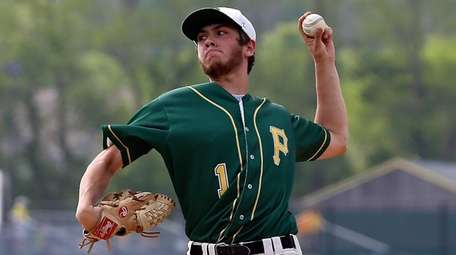 Ward Melville starting pitcher Anthony Kay delivers during