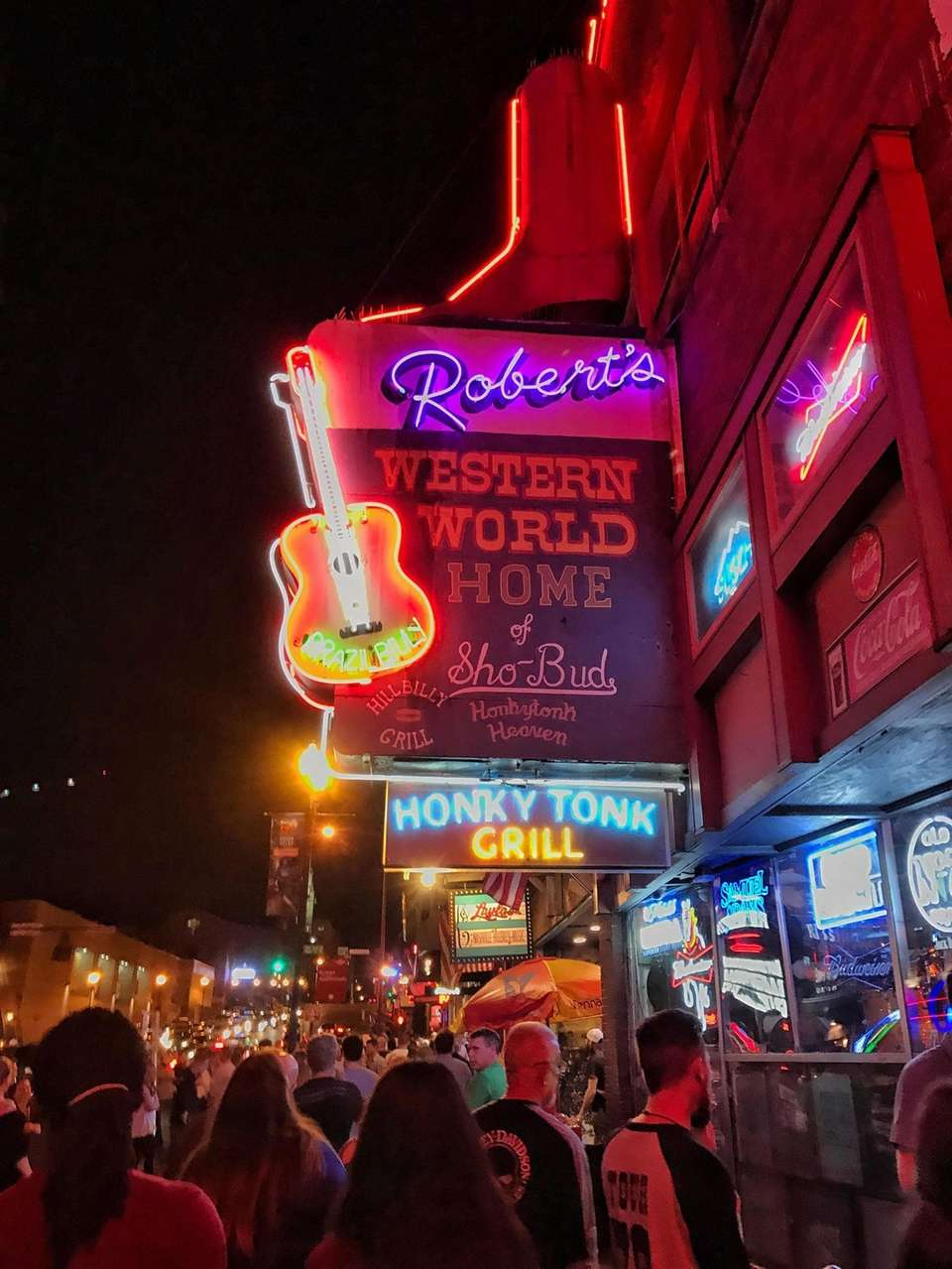 Neon signs for the honky tonks, restaurants and
