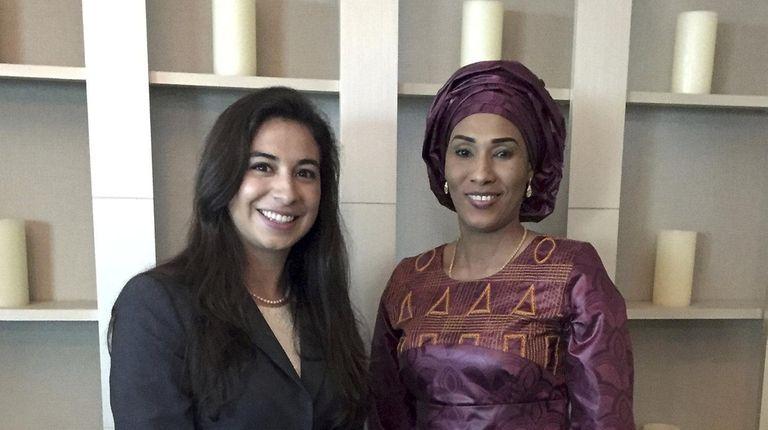 Ashleigh DeLuca, left, with Fatoumatta Bah-Barrow, first lady