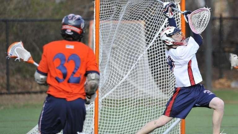 Manhasset's Drew Belinsky (32) fires the ball past