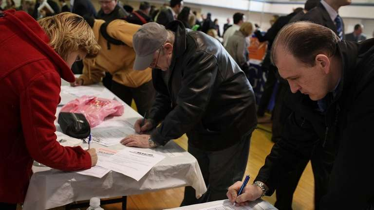 Job seekers fill out applications at a UJA-Federation