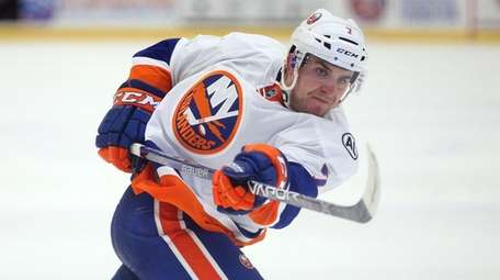 Islanders prospect Devon Toews (7) participates in the
