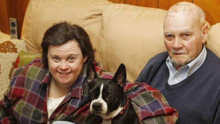 Monica Merritt with her dog, Max, and father,