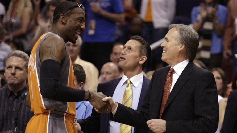 Phoenix Suns forward Amare Stoudemire, left, greets New