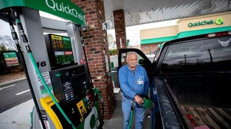 Terry Gallagher of Amityville fills his truck with