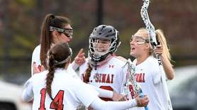 Goalie Sienna Massullo of Mt. Sinai celebrates with