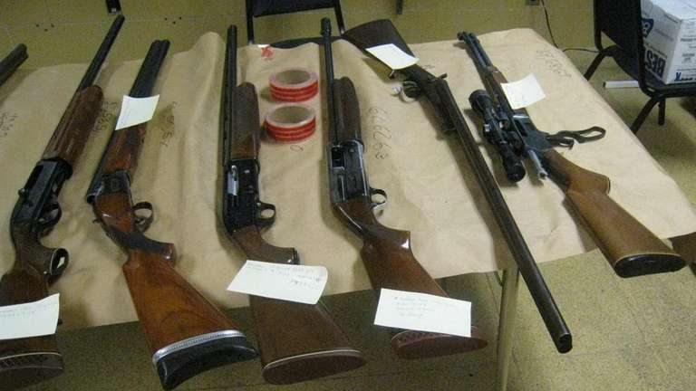 Police arrest four and recover 30 firearms from