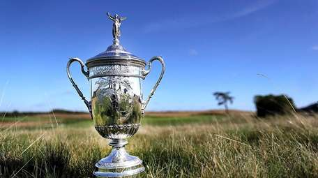 The U.S. Open trophy sits in the fescue