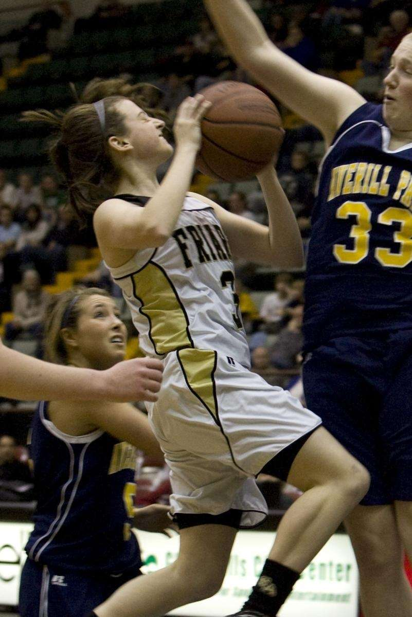 St. Anthony's Shannon White goes up for a