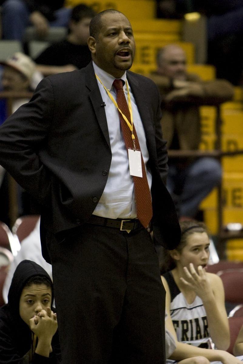 St. Anthony's coach Ken Parham yells instruction during