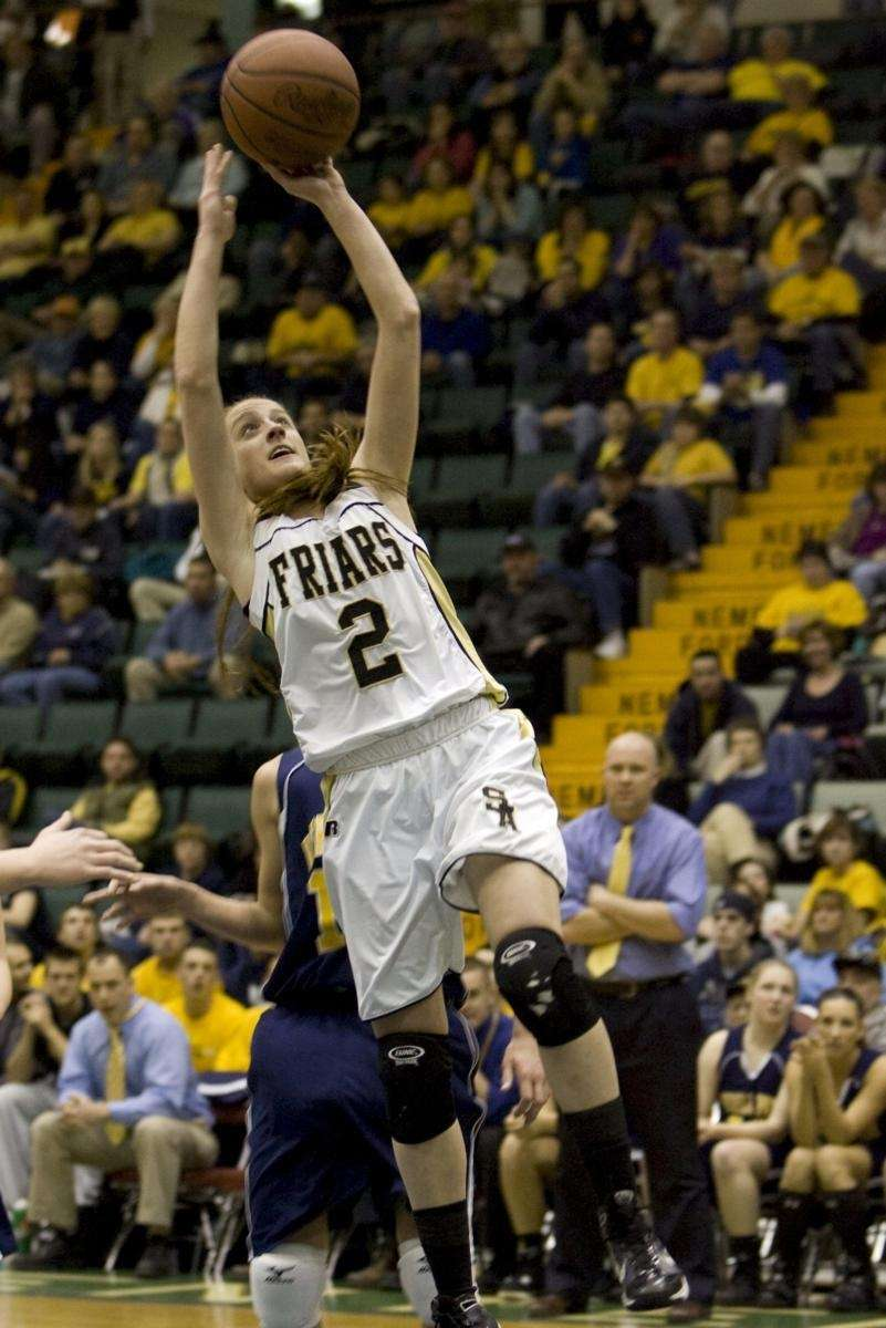 St. Anthony's Carolyn Lizza goes in for a