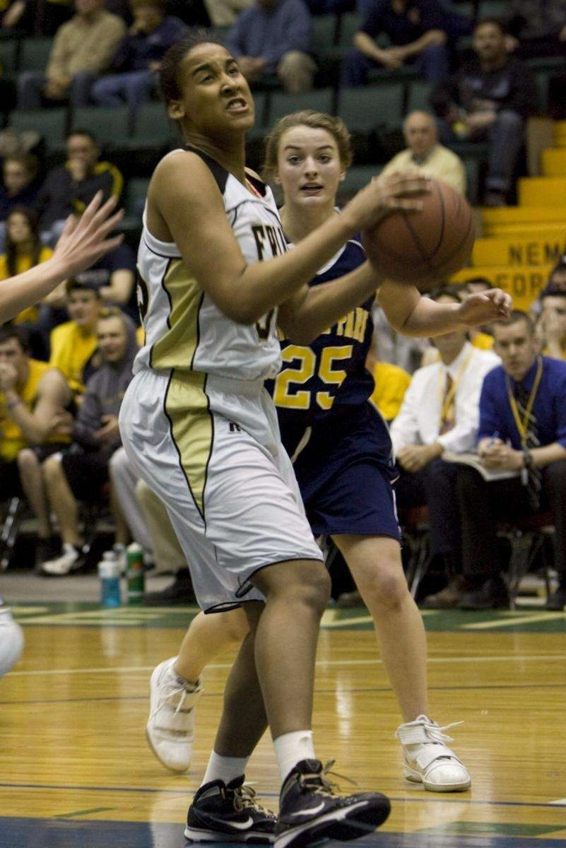 St. Anthony's Symone Kelly drives in for a