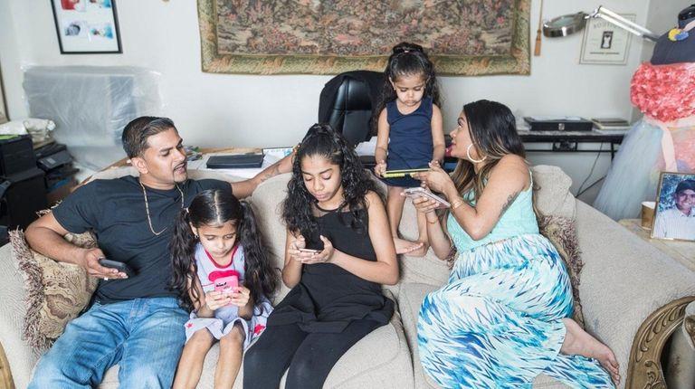 The Baijnauth family, from left, Kevin, Amina, 7,