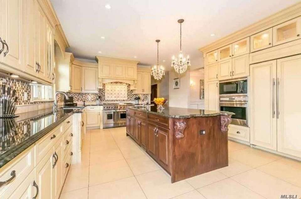 The gourmet eat-in kitchen in this Roslyn Heights