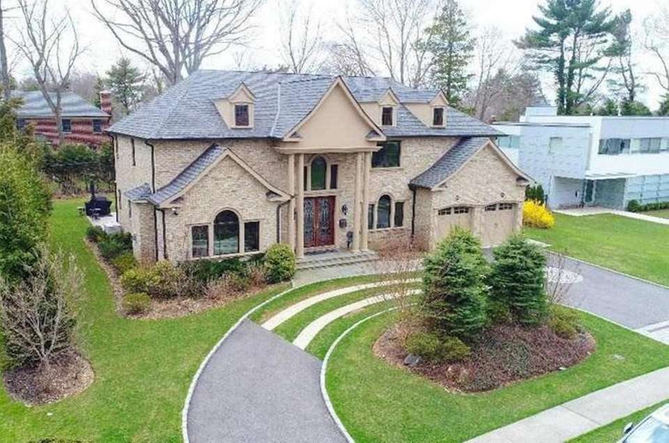 This Roslyn Heights Colonial includes six bedrooms and