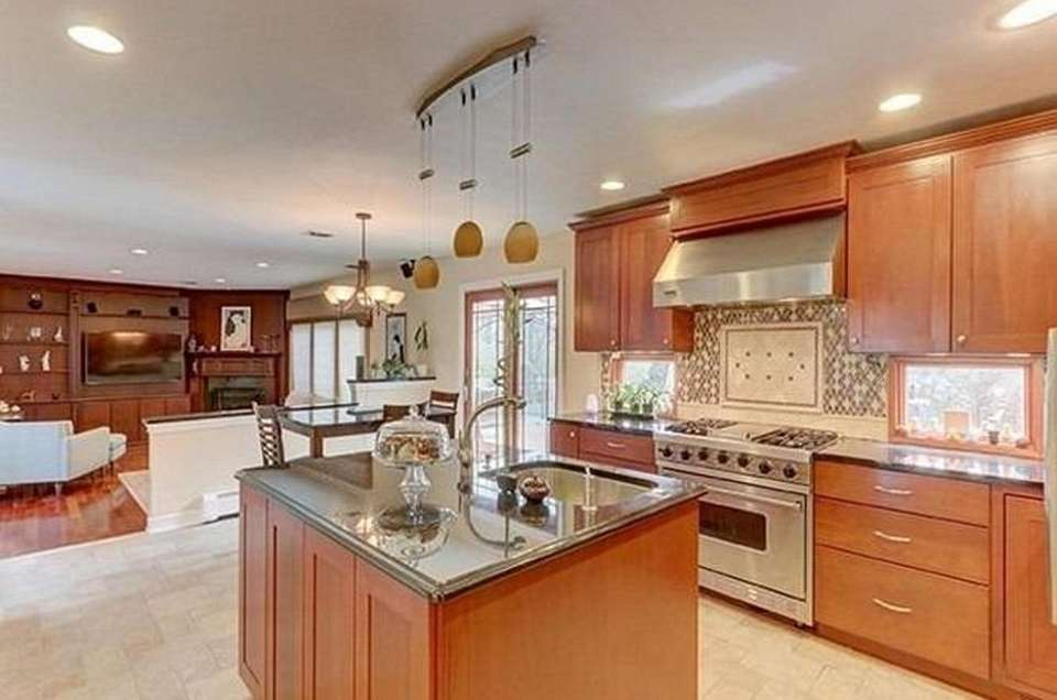 The granite kitchen in this Commack Colonial features