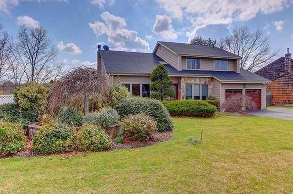This Commack Colonial includes four bedrooms and 2