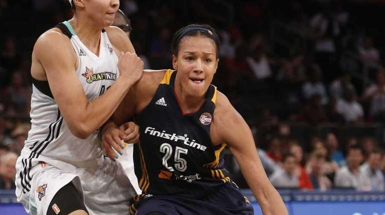 Marissa Coleman of the Indiana Fever drives to