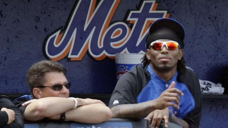 New York Mets shortstop Jose Reyes, right, watches