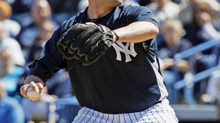 New York Yankees pitcher Joba Chamberlain delivers a