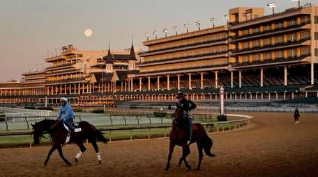 The full moon sets beyond the grandstands at