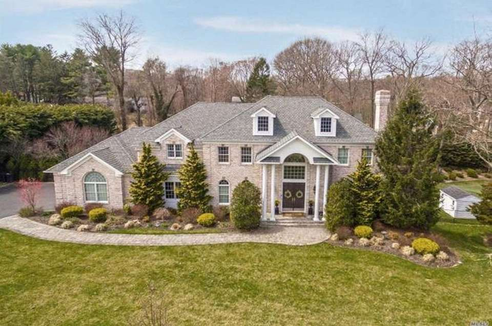 This Northport Colonial includes five bedrooms and 4
