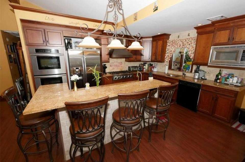 The eat-in kitchen in this West Islip high-ranch