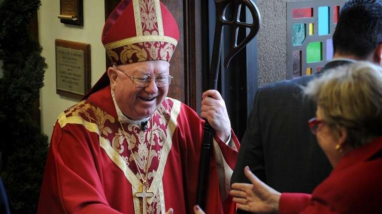 Bishop William Murphy greets parishioners after saying Palm