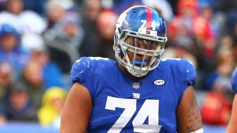 Eli Manning #10 and Ereck Flowers #74 of